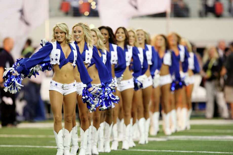 The Dallas Cowboys Cheerleaders perform during their game against the Buffalo Bills at Cowboys Stadium in Arlington, Texas, Sunday, Nov. 13, 2011.  JERRY LARA/glara@express-news.net Photo: JERRY LARA, Express-News / SAN ANTONIO EXPRESS-NEWS