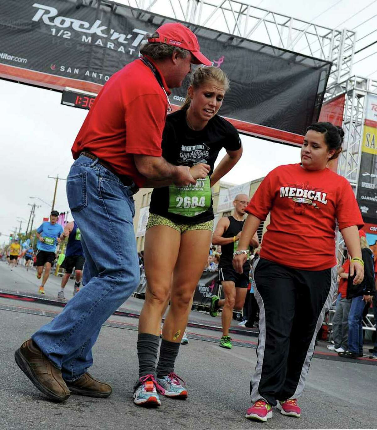 A runner receives medical attention after finishing the half marathon during the 2011 San Antonio Rock 'n' Roll Marathon and Half Marathon in San Antonio, Texas on November 13, 2011. John Albright / Special to the Express-News.