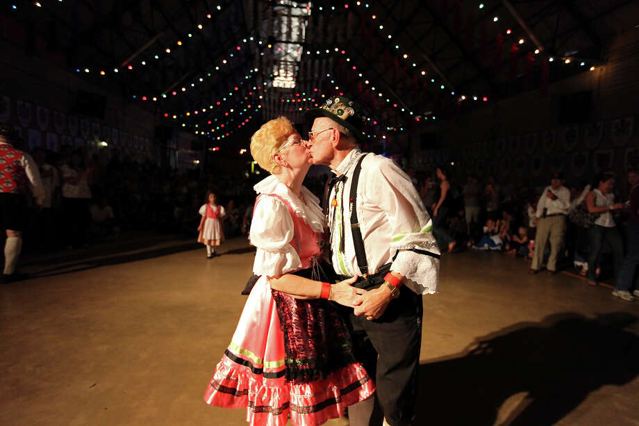 Gwen (left) and Lee Roy Petersen kiss after taking part in the polka contest during the final day of the 51st annual Wurstfest Sunday Nov. 13, 2011 in New Braunfels, Tx. In 2008 the Petersens were the first place winners. (PHOTO BY EDWARD A. ORNELAS/eaornelas@express-news.net) Photo: EDWARD A. ORNELAS, SAN ANTONIO EXPRESS-NEWS / eaornelas@express-news.net