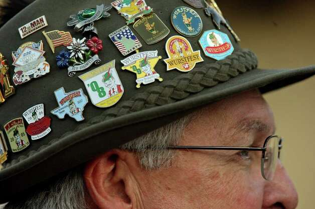 Doug Graves wears commemorative pins on his hat during the final day of the Wurstfest. Photo: EDWARD A. ORNELAS, SAN ANTONIO EXPRESS-NEWS / © SAN ANTONIO EXPRESS-NEWS (NFS)