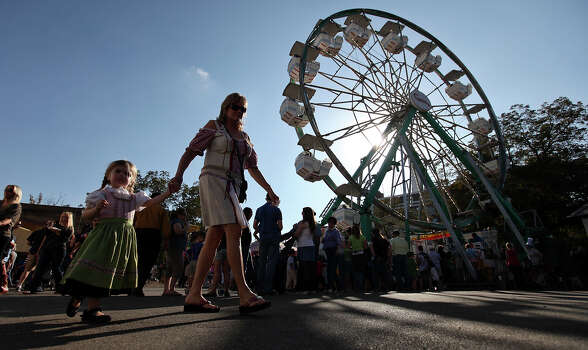 People attending the final day of the 51st annual Wurstfest take in the sights Sunday Nov. 13, 2011 in New Braunfels, Tx. (PHOTO BY EDWARD A. ORNELAS/eaornelas@express-news.net) Photo: EDWARD A. ORNELAS, SAN ANTONIO EXPRESS-NEWS / © SAN ANTONIO EXPRESS-NEWS (NFS)