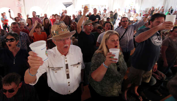Barry (center left) and Mary Irwin toast with other while listening to The Sauerkrauts perform during the final day of the 51st annual Wurstfest Sunday Nov. 13, 2011 in New Braunfels, Tx. (PHOTO BY EDWARD A. ORNELAS/eaornelas@express-news.net) Photo: EDWARD A. ORNELAS, SAN ANTONIO EXPRESS-NEWS / eaornelas@express-news.net