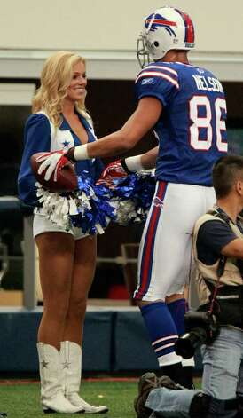 Buffalo Bills wide receiver David Nelson (86) gives the football to his girlfriend, Dallas Cowboys Cheerleader Kelsi Reich, after he scored a touchdown during the first half of an NFL football game in Arlington, Texas, on Sunday, Nov. 13, 2011.  MANDATORY CREDIT  MAGS OUT  TV OUT Photo: The Dallas Morning News, Michael Ainsworth
