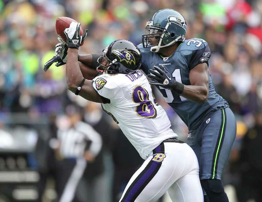 SEATTLE - NOVEMBER 13:  Safety Kam Chancellor #31 of the Seattle Seahawks breaks up a pass to Ed Dickson #84 of the Baltimore Ravens at CenturyLink Field on November 13, 2011 in Seattle, Washington. Photo: Otto Greule Jr, Getty Images / 2011 Getty Images