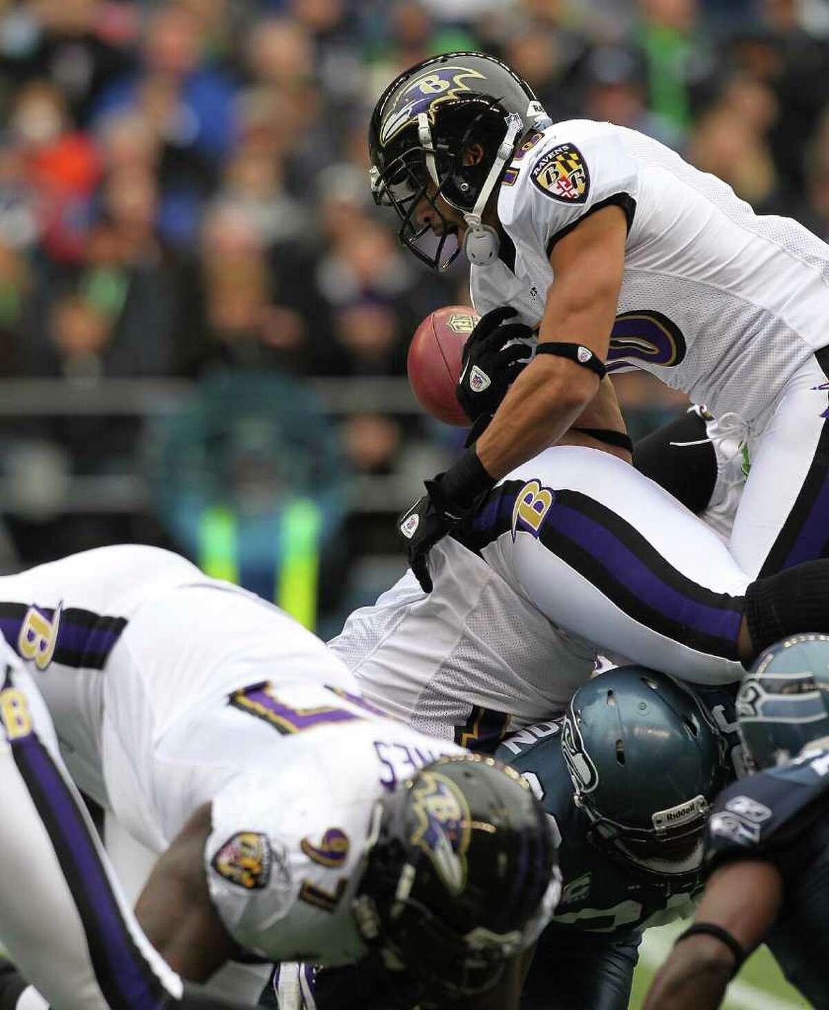 SEATTLE - NOVEMBER 13: Kick returner David Reed #16 of the Baltimore Ravens fumbles against the Seattle Seahawks at CenturyLink Field on November 13, 2011 in Seattle, Washington.
