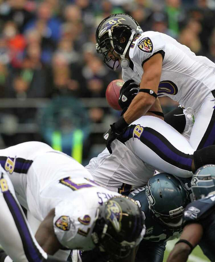 SEATTLE - NOVEMBER 13:  Kick returner David Reed #16 of the Baltimore Ravens fumbles against the Seattle Seahawks at CenturyLink Field on November 13, 2011 in Seattle, Washington. Photo: Otto Greule Jr, Getty Images / 2011 Getty Images