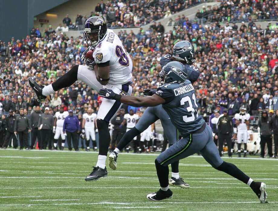 SEATTLE - NOVEMBER 13:  Tight end Ed Dickson #84 of the Baltimore Ravens makes a catch against Kam Chancellor #31 of the Seattle Seahawks at CenturyLink Field on November 13, 2011 in Seattle, Washington. Photo: Otto Greule Jr, Getty Images / 2011 Getty Images