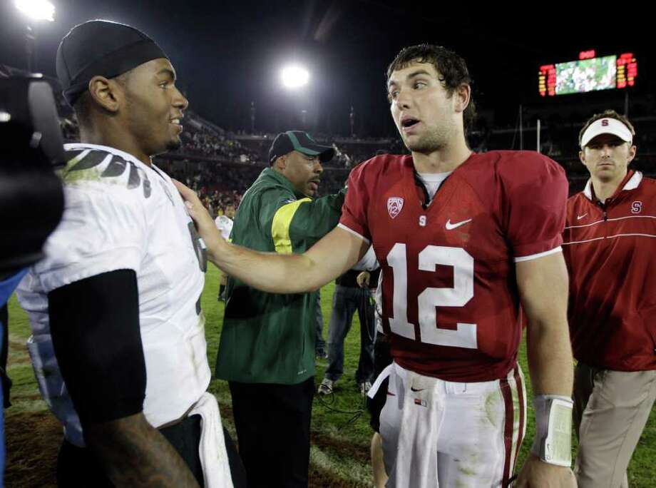 Oregon's Darron Thomas (left) and Stanford's Andrew Luck were two high school quarterbacks in Texas that UT never seriously recruited. Photo: AP