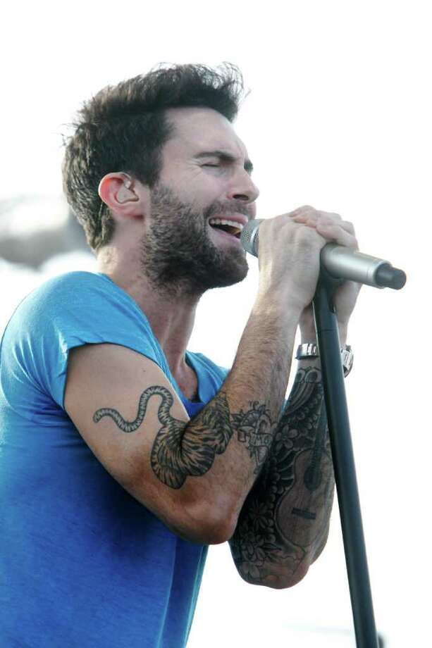 Maroon 5 lead singer Adam Levine performs during a concert on Pier 21 as part of the new Carnival Magic celebrations in Galveston. Photo: Mayra Beltran, Houston Chronicle / © 2011 Houston Chronicle