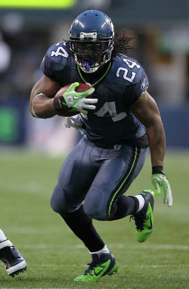 SEATTLE - NOVEMBER 13:  Running back Marshawn Lynch #24 of the Seattle Seahawks rushes against the Baltimore Ravens at CenturyLink Field on November 13, 2011 in Seattle, Washington. The Seahawks defeated the Ravens 22-17. Photo: Otto Greule Jr, Getty Images / 2011 Getty Images