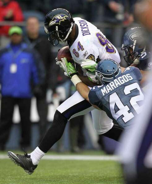 SEATTLE - NOVEMBER 13:  Tight end Ed Dickson #84 of the Baltimore Ravens makes a touchdown catch aga