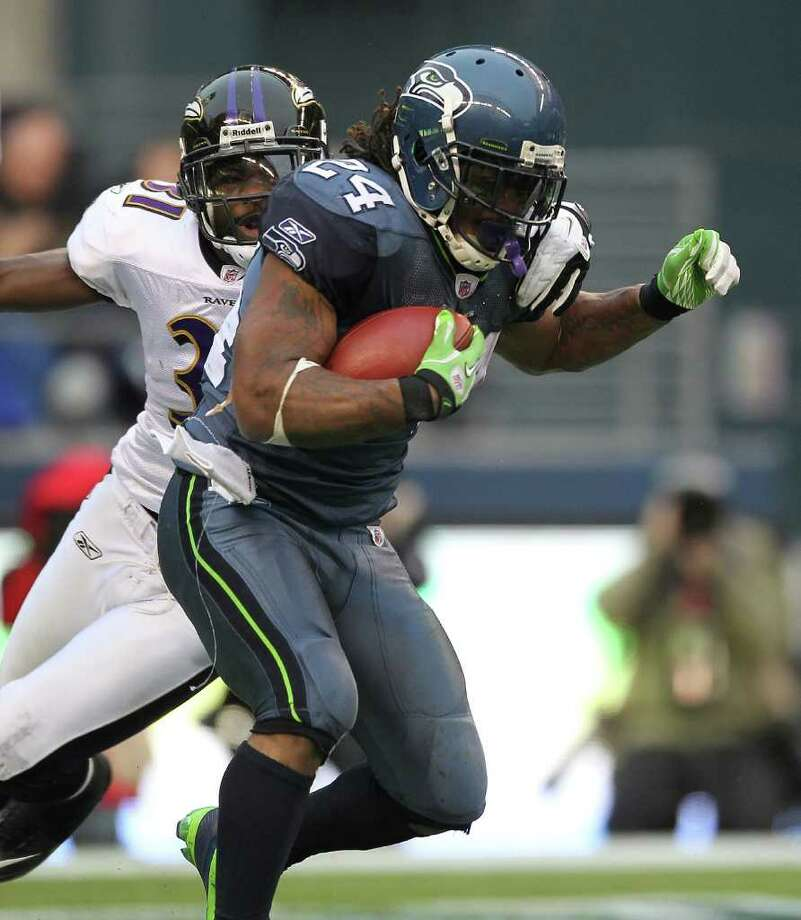 SEATTLE - NOVEMBER 13:  Running back Marshawn Lynch #24 of the Seattle Seahawks rushes against Bernard Pollard #31 of the Baltimore Ravens at CenturyLink Field on November 13, 2011 in Seattle, Washington. The Seahawks defeated the Ravens 22-17. Photo: Otto Greule Jr, Getty Images / 2011 Getty Images