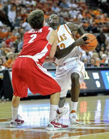 Texas guard Myck Kabongo, right, drives against Boston University guard Matt Griffin, left, during the first half of the TicketCity Legends Classic NCAA college basketball game Sunday, Nov. 13, 2011, in Austin, Texas. Photo: AP