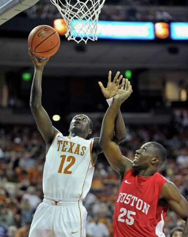 Texas guard Myck Kabongo, left, lays the ball up against Boston University forward Patrick Hazel, right, during the first half of the TicketCity Legends Classic NCAA college basketball game Sunday, Nov. 13, 2011, in Austin, Texas. Photo: AP