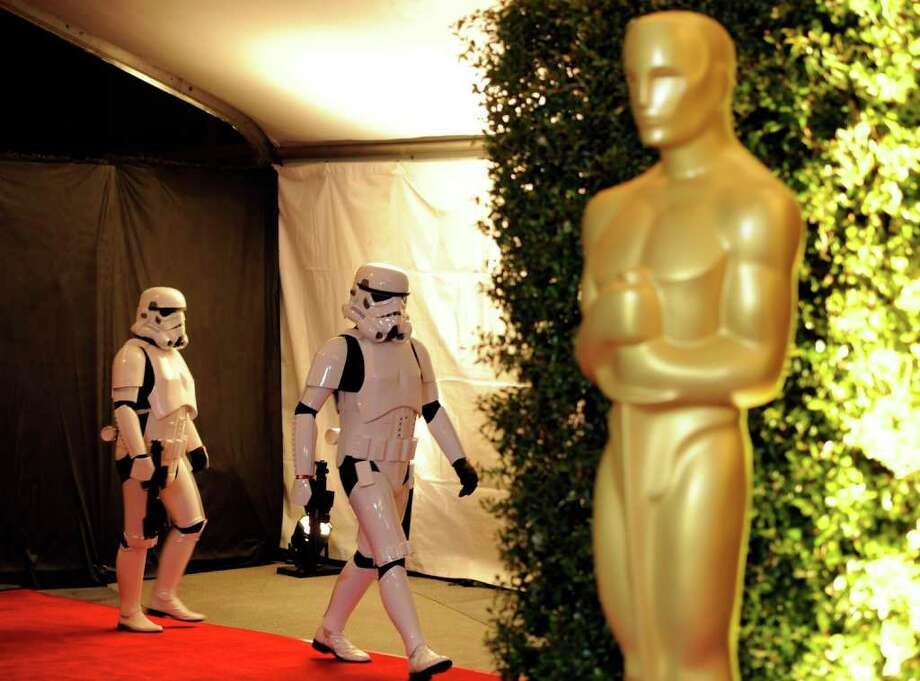 "Actors dressed as ""Stormtroopers"" from the ""Star Wars"" franchise arrive as presenters at the Academy of Motion Picture Arts and Sciences' 2011 Governors Awards, Saturday, Nov. 12, 2011, in Los Angeles. The Governors Awards is an annual event celebrating awards conferred by the Academy's Board of Governors, with highlights being incorporated into next year's Academy Awards show. (AP Photo/Chris Pizzello) Photo: Chris Pizzello / AP"
