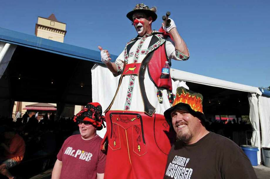 "Kenneth Heinzmann (left) and Chris Iacovino stand with Kenneth ""Gator the Clown"" Jones at Wurstfest. Photo: EDWARD A. ORNELAS, SAN ANTONIO EXPRESS-NEWS / © SAN ANTONIO EXPRESS-NEWS (NFS)"