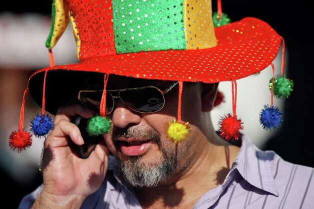 Jimmy Delgado talks on his cell phone during the final day of the 51st annual Wurstfest Sunday. Photo: EDWARD A. ORNELAS, SAN ANTONIO EXPRESS-NEWS / © SAN ANTONIO EXPRESS-NEWS (NFS)
