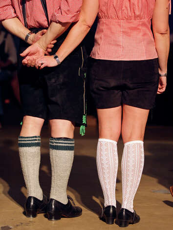 FOR METRO - Horst and Kimberly Schaffner hold hands in the polka contest during the final day of the 51st annual Wurstfest Sunday Nov. 13, 2011 in New Braunfels, Tx. (PHOTO BY EDWARD A. ORNELAS/eaornelas@express-news.net) Photo: EDWARD A. ORNELAS, SAN ANTONIO EXPRESS-NEWS / eaornelas@express-news.net