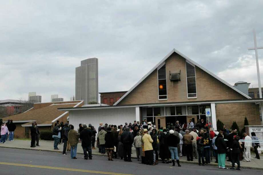 People gather for a celebration outside of the Union Missionary Baptist Church on Morton Avenue on Sunday, Nov. 13, 2011 in Albany.  The community was holding the event to mark the new CDTA bus routes that service new areas of the city.   (Paul Buckowski / Times Union) Photo: Paul Buckowski / 00015383A