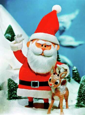 ADVANCE FOR TUESDAY PMS, NOV. 24--Santa stands beside his favorite reindeer, Rudolph, in a scene from  'Rudolph the Red-Nosed Reindeer,' television's  longest-running special. CBS will rebroadcast the classic animated feature this Christmas season,  on Nov. 30  at 8 p.m., EST. It was originally broadcast on CBS (AP Photo/CBS) / CBS