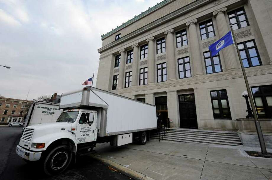 A moving van unloads the Albany County Clerk's office materials at the front of the old Albany County Courthouse in Albany, N.Y. November 11, 2011 returning the Clerk's Office to it's former location.    (Skip Dickstein/Times Union) Photo: Skip Dickstein / 00015377A