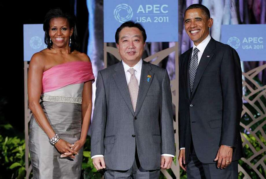 U.S. President Barack Obama and First Lady Michelle Obama greets Japanese Prime Minister Yoshihiko Noda before the APEC leaders dinner in Honolulu, on Saturday, Nov. 12, 2011.  (AP Photo/Charles Dharapak) Photo: Charles Dharapak / AP