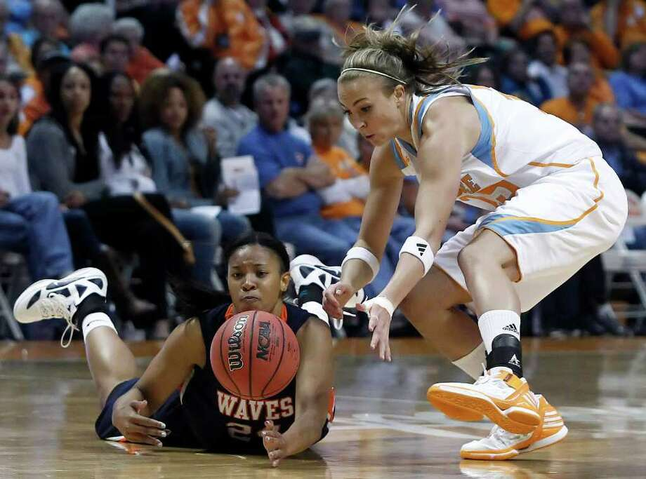 Tennessee Lady Volunteers forward Alicia Manning, right, battles for the ball with Pepperdine's T'Keyah Shealy (24)during the first half of an NCAA college basketball game Sunday, Nov. 13, 2011 in Knoxville, Tenn.  (AP Photo/Wade Payne) Photo: Wade Payne / FR23601 AP
