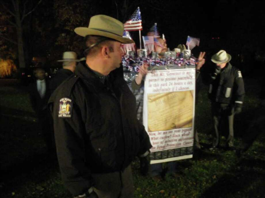 Bradley Russell, 39, wearing a poster of the first amendment, is arrested Sunday night in Academy Park. He was arrested Saturday night, and has rallied fellow Occupy Albany demonstrators to cross from Academy Park into Lafayette Park. (Jimmy Vielkind/Times Union)
