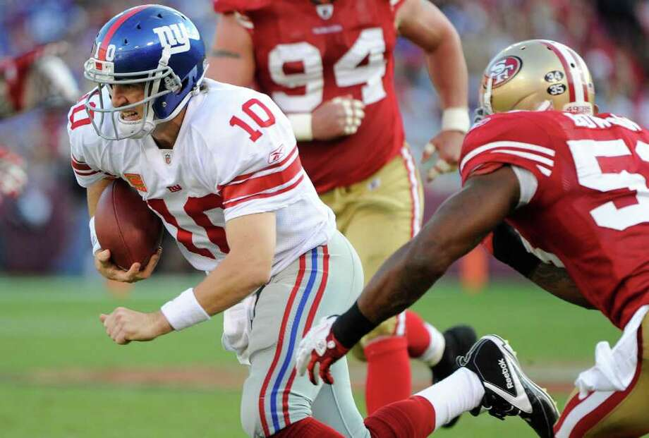 SAN FRANCISCO - NOVEMBER 13:  Eli Manning #10 of the New York Giants scrambles with the ball trying to avoid the tackle of NaVorro Bowman #53 of the San Francisco 49ers during an NFL football game at Candlestick Park November 13, 2011 in San Francisco, California. The 49ers won the game 27-20. (Photo by Thearon W. Henderson/Getty Images) Photo: Thearon W. Henderson