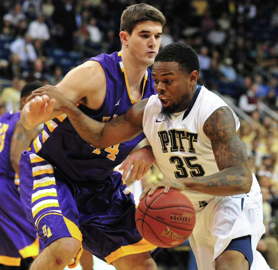 Pitt's Nasir Robinson drives past Albany's John Puk in the first half at Petersen Events Center Nov. 11, 2011. (Chaz Palla | Tribune-Review) Photo: CAP