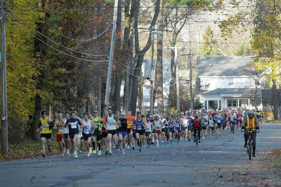 Runners head down Central Parkway during Stockade-athon 15K Road Race on Sunday, Nov. 13, 2011 in Schenectady.  The annual race began back in 1976.   (Paul Buckowski / Times Union) Photo: Paul Buckowski / 00015336A