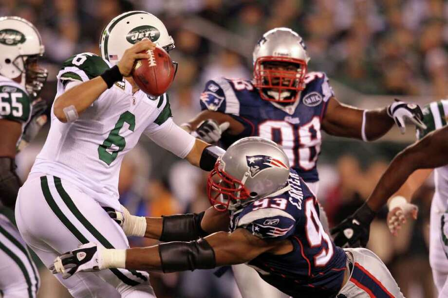 EAST RUTHERFORD, NJ - NOVEMBER 13:  Mark Sanchez #6 of the New York Jets gets sacked by Andre Carter #93 of the New England Patriots at MetLife Stadium on November 13, 2011 in East Rutherford, New Jersey.  (Photo by Nick Laham/Getty Images) Photo: Nick Laham