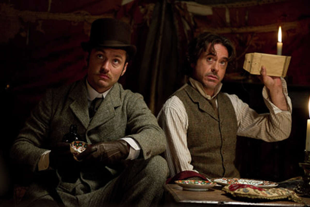 (L-R) Jude Law as Dr. Watson and Robert Downey Jr. as Sherlock Holmes in