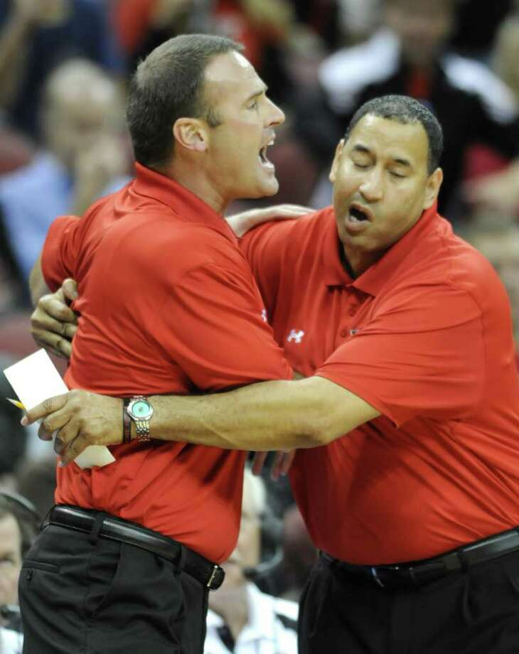Lamar assistant coach Joe Price restrains head coach Pat Knight, left, following a technical foul called against him during the first half of their NCAA men's college basketball game against Louisville, Sunday, Nov. 13, 2011, in Louisville, Ky. Louisville defeated Lamar 68-48. (AP Photo/Timothy D. Easley) Photo: Timothy D. Easley, FRE