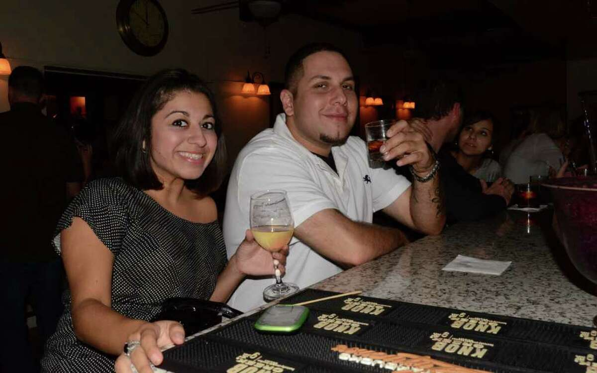 Fatima and Steven Molina (cq) cheers to a night off work at Mon Ami on October 22, 2011. Robin Johnson
