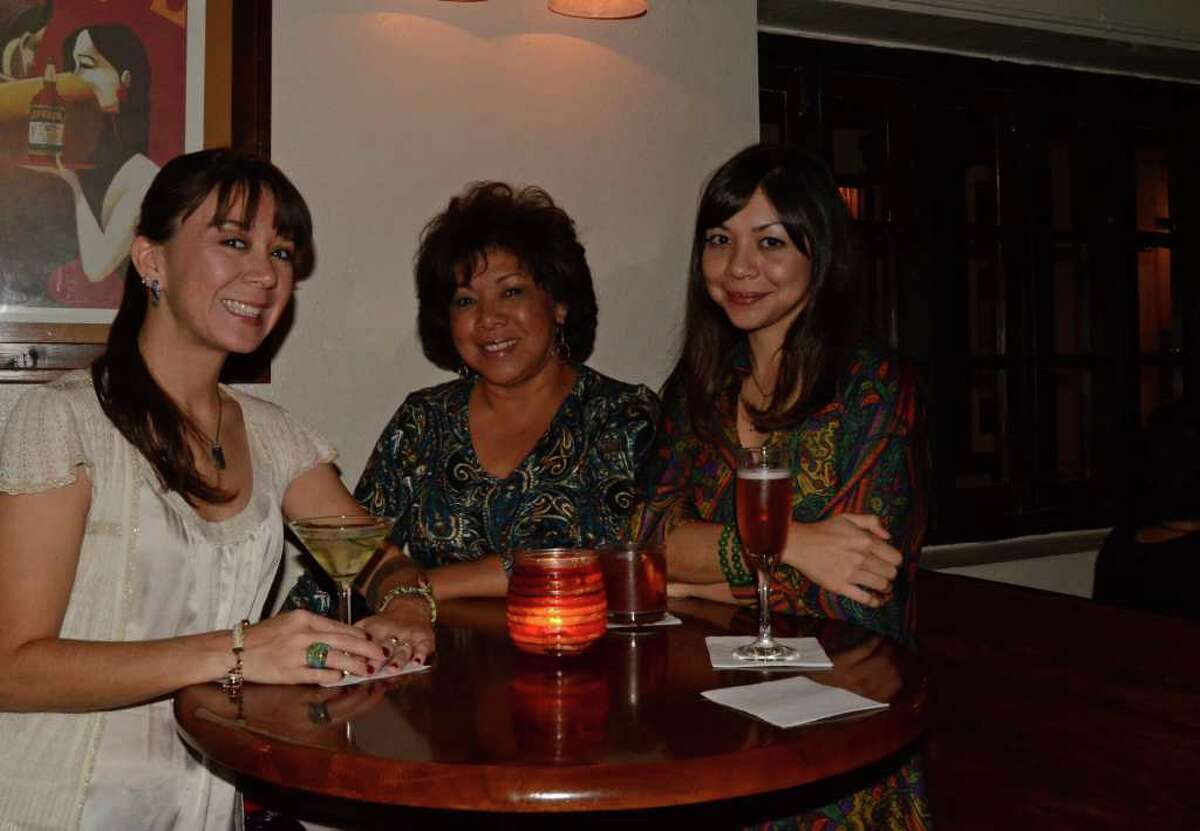 Regulars Dre Santos (cq) (left), Cindy Skruhale (cq) and Sarah Boyd meet at their usual, Mon Ami, for cocktails and martinis on October 22, 2011.