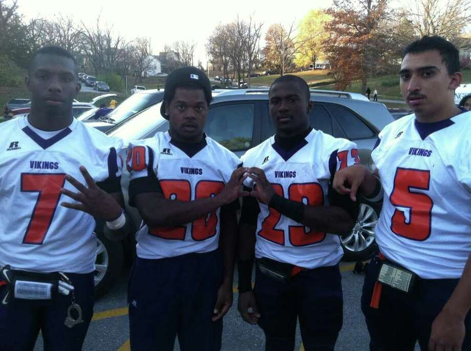 "Former Central and West Brook football players hold up the numbers ""409"" after helping the Missouri Valley College football team win a Heart of America Conference title on Saturday. Michael Barnes, left, is a defensive back from Central while Nijel Daw (20) and Keith O'Neal (29) are former Central running backs. Bruce Reyes (5) is a former West Brook quarterback. Missouri Valley beat Central Methodist 33-7 on Saturday, Nov. 12, 2011. Photo: Provided By Bruce Reyes"