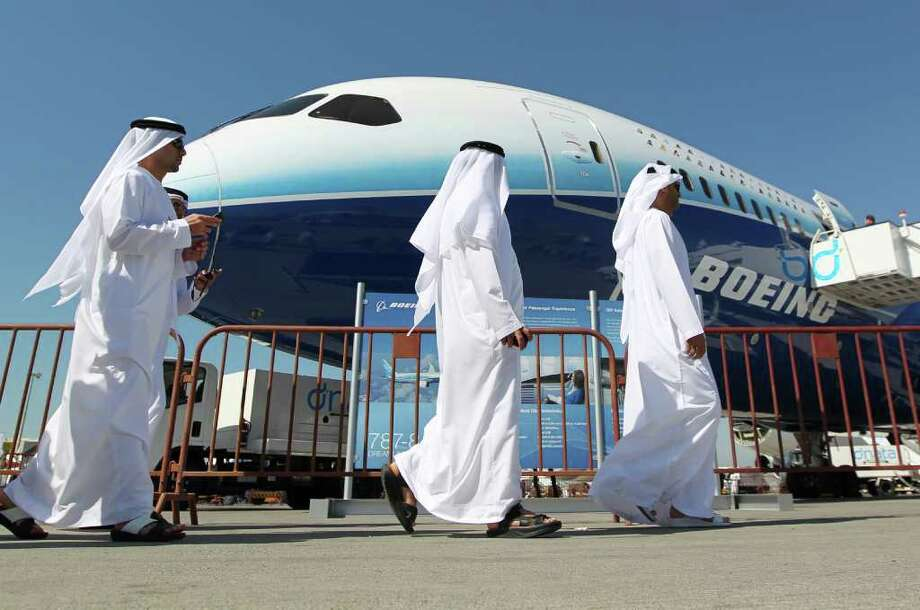 Boeing has made quite a splash at this year's Dubai Airshow, which opened Sunday. The U.S. plane maker has unveiled an upgraded interior of its third flight-test 787 Dreamliner, aimed at showing off the airliner's capabilities, announced its first 787 order of the year and booked its largest-ever order, by value, for 50 777s. Here are some shots from the show, starting with Emirati men visiting the 787 on Monday, November 14, 2011. Photo: KARIM SAHIB, AFP/Getty Images / 2011 AFP
