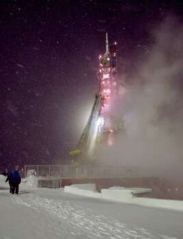 The Soyuz TMA-22 rocket is seen at the Soyuz launch pad during a snow storm the morning of the launch of Expedition 29 to the International Space Station at the Baikonur Cosmodrome in Kazakhstan, Monday, Nov. 14, 2011. The Russian spacecraft carrying an American and two Russians blasted off Monday in a faultless launch. Photo: Carla Cioffi, Associated Press / (NASA/Carla Cioffi)