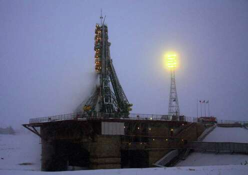Russia's Soyuz TMA-22 spacecraft of the International Space Station (ISS) Expedition 30 stands atop a launch pad in the Russian leased Kazakh Baikonur cosmodrome, early on November 14, 2011, shortly before the launch. Photo: STR, Getty / AFP