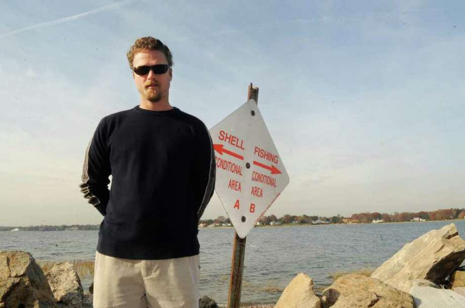 Oyster company owner Jardar Nygaard stands near a shellfishing area at Greenwich Point Monday, Nov. 14, 2011.  He is upset about a sewage spill in Greenwich Cove that closed his oyster harvest. Photo: Helen Neafsey / Greenwich Time