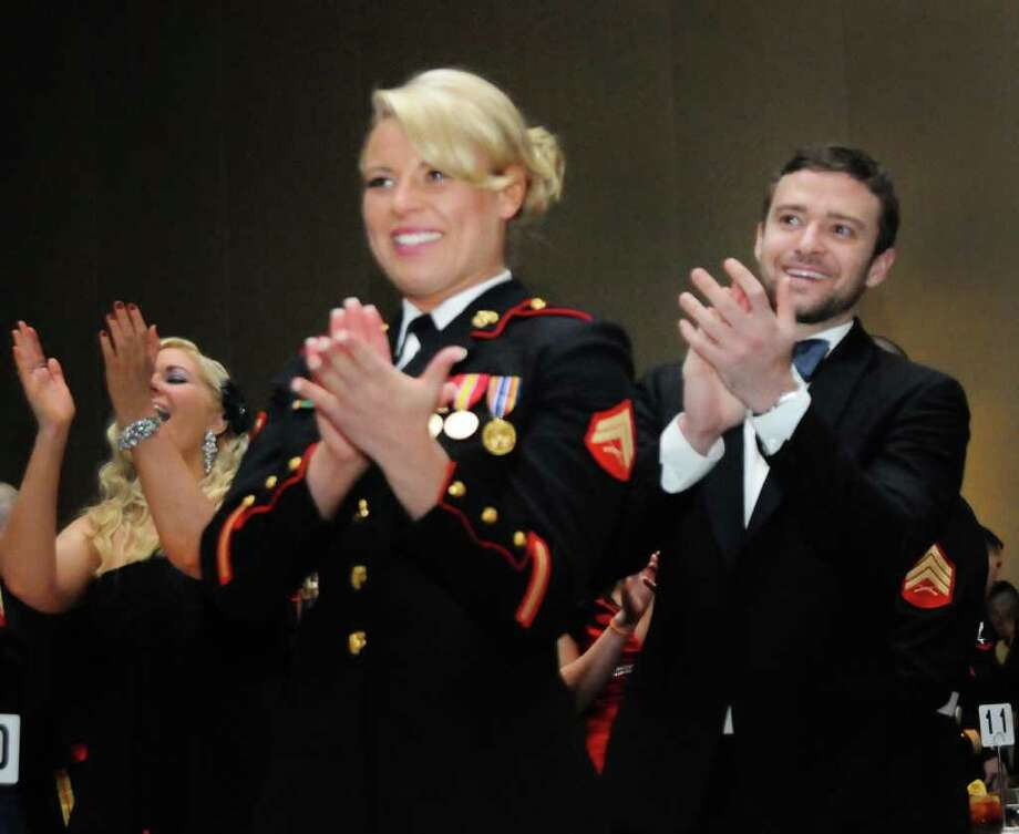 In this Nov. 12, 2011 photo provided by Marine Corps Base Quantico Public Affairs, Cpl. Kelsey De Santis and her date Justin Timberlake applaud guest speaker retired Sgt. Maj. Ralph Larsen at the Instructor Battalion Marine Corps Ball in Richmond, Va. The Corps celebrated their 236th birthday on Nov. 10. (AP Photo/Marine Corps Base Quantico Public Affairs, Lance Cpl. Emmanuel Ramos) Photo: Lance Cpl. Emmanuel Ramos
