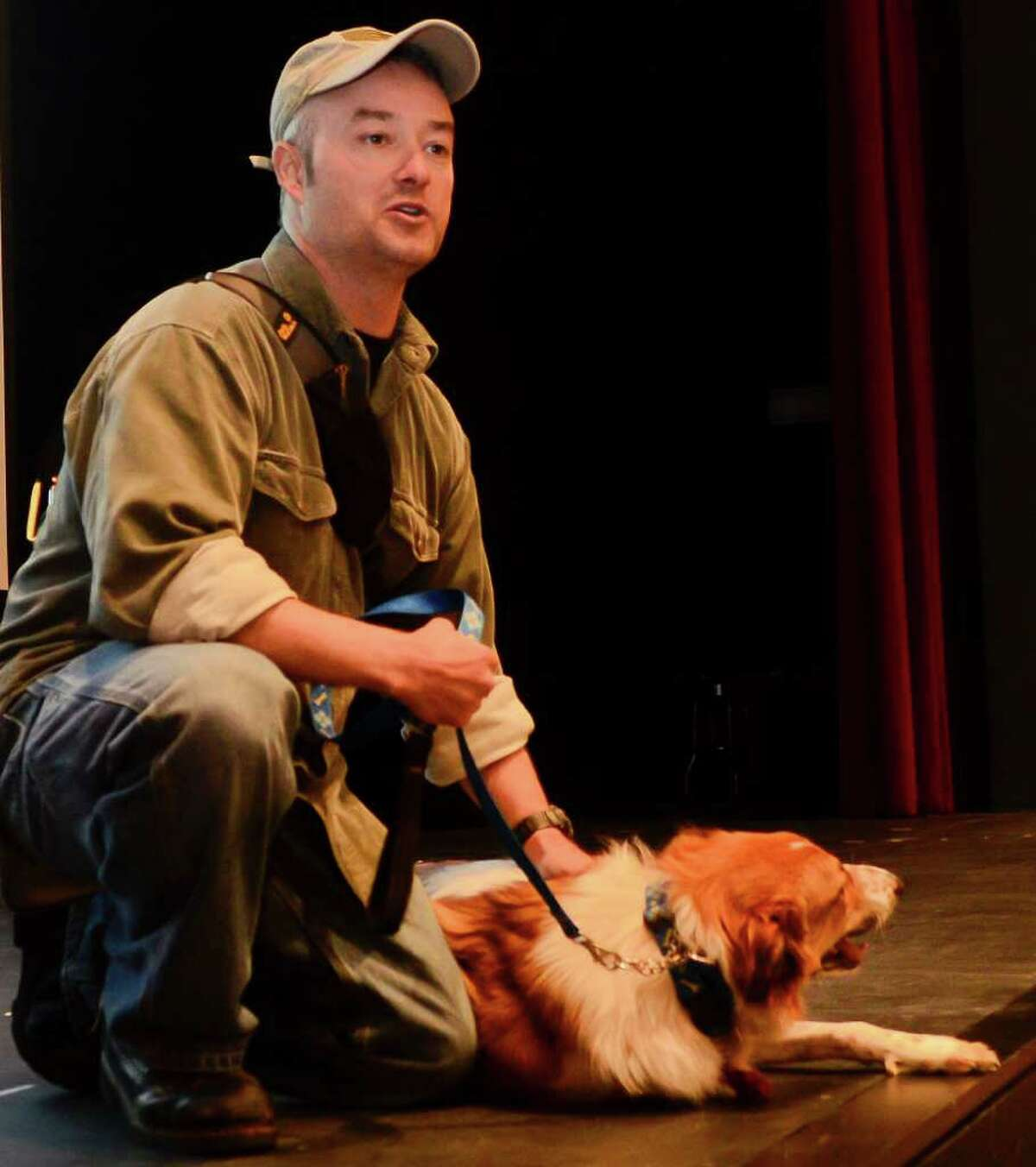 Captain Steve Johnston, New Fairfield, introduces Oso the dog to students at King Low Heywood Thomas School in Stamford, CT on Wednesday, November 9, 2011. Oso was rescued through the Baghdad Pups program, which helps U.S. troops safely transport home the companion animals they befriend in the war zone.