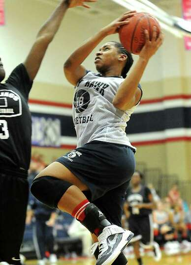 HJ's Jasmine Smith goes up for two during a scrimmage against Central at Hardin-Jefferson High Schoo