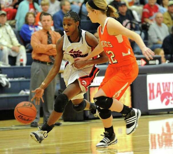 HJ's Kesha Broussard drives the ball as Orangefield's Morgan Moss guards at Hardin-Jefferson High Sc
