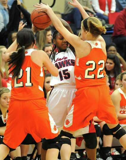 HJ's Kesha Broussard is double teamed by Orangefield's Kassidy Hayes and Morgan Moss at Hardin-Jeffe