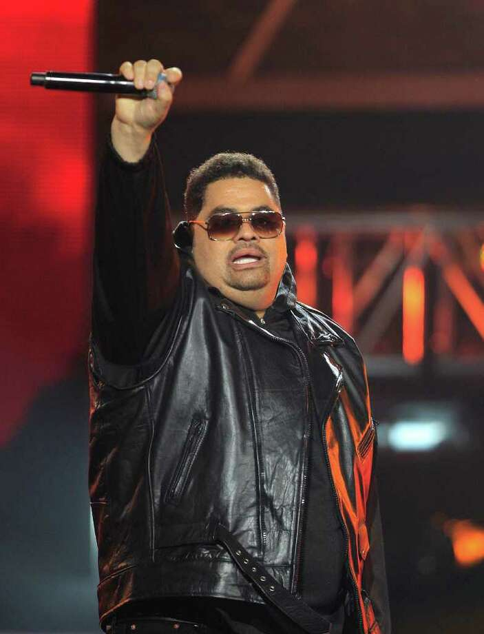 FILE - In this Oct. 1, 2011 file photo, rapper Heavy D, also known as Dwight Arrington Myers, performs during the BET Hip Hop Awards in Atlanta. A representative confirmed Tuesday, Nov. 8, 2011 that the singer and former leader of Heavy D & the Boyz died. A private funeral for Heavy D will be held Friday, Nov. 18, at Grace Baptist Church in Mount Vernon, N.Y. Rap mogul Diddy and the Rev. Al Sharpton will speak at the funeral. (AP Photo/David Goldman, file) Photo: David Goldman