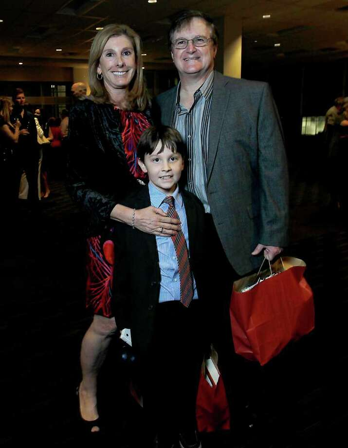 Lynne and Lewis Gottschalk with son, Zachary, 10, during the 32nd annual Houston Chronicle Book & Author dinner at the Norris Center's Red Oak Ballroom at City Centre,  Nov. 13, 2011. ( Karen Warren / Houston Chronicle ) Photo: Karen Warren / © 2011 Houston Chronicle