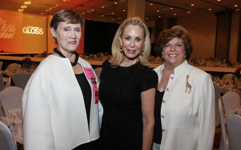 Gary Fountain PHOTOs Nutcracker Market chair Sharon Erskine, from left, with Saks Fifth Avenue Fashion Show and Luncheon chairs Carol Simmons and Karen Hartnett. Photo: Gary Fountain / Copyright 2011 Gary Fountain