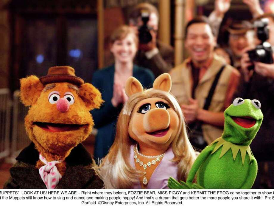 "Fozzie Bear, Miss Piggy and Kermit are back together in ""The Muppets,"" which opens NOv. 23, 2011. Photo: Scott Garfield, Walt Disney Co. / ©Disney Enterprises, Inc. All Rights Reserved."